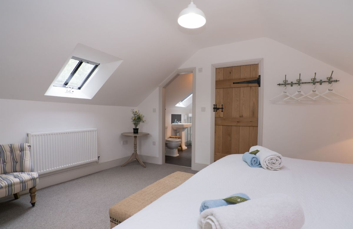 First floor:  Double bedroom with 5' king size bed and en-suite shower room