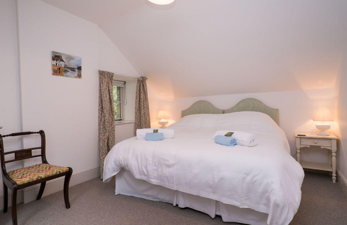 First floor:  Double bedroom with 6' king size zip and link beds and en-suite bathroom