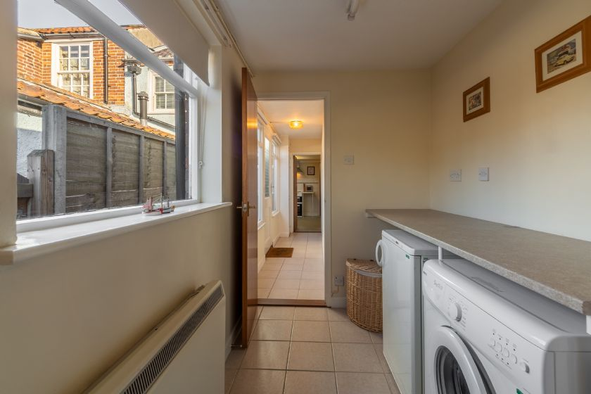 Ground floor: Utility room with fridge and washing machine