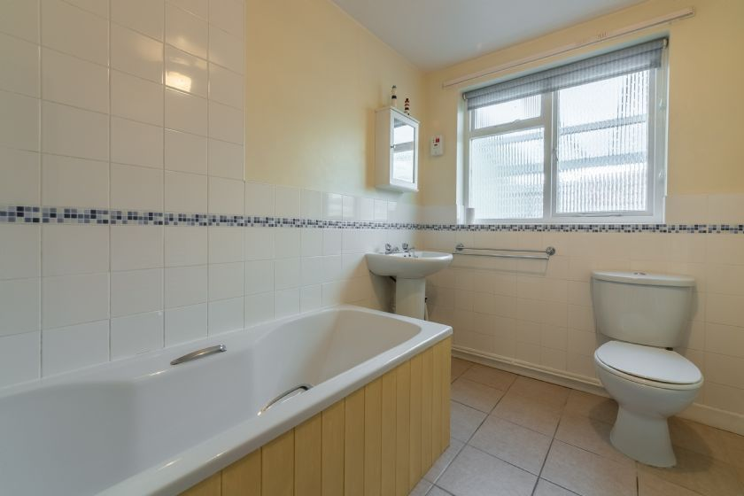 Ground floor: Bathroom with bath and shower over, wash basin and WC