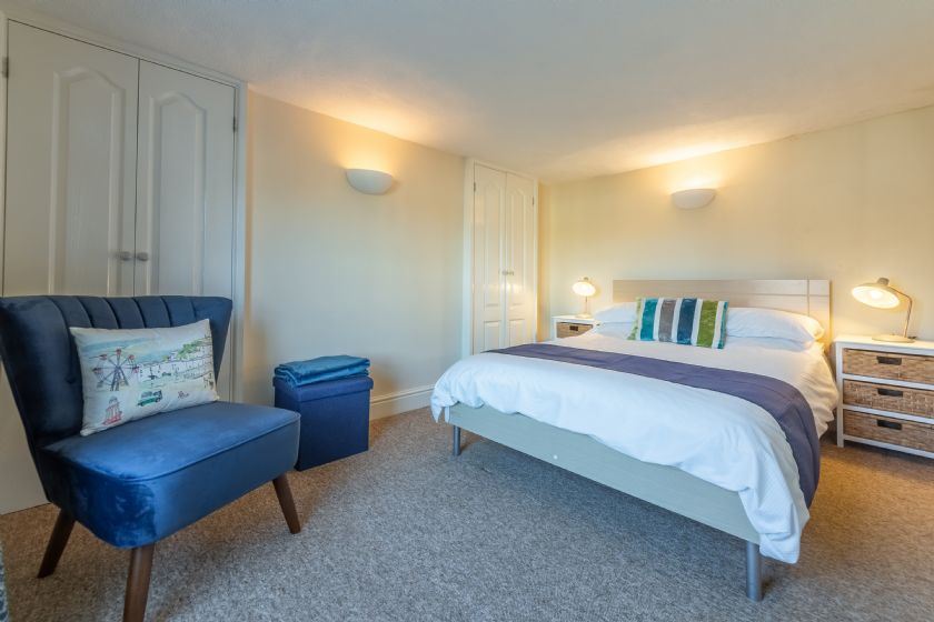 First floor: Main bedroom with double bed, built in hanging space and chest of drawers