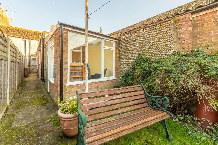 Rear garden with sun room