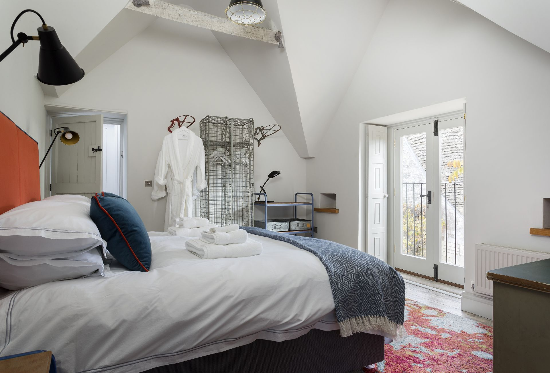The Stables: First floor bedroom with king-size bed, Juliet balcony and en-suite bathroom