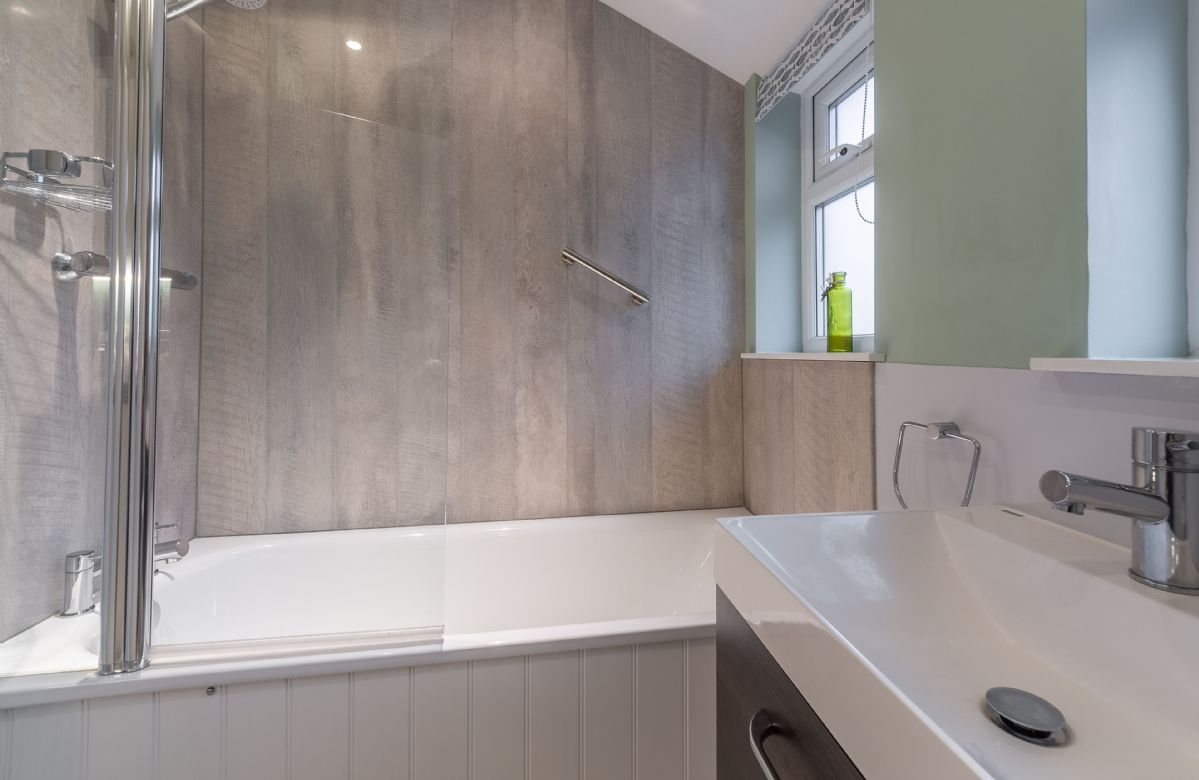 Ground floor: Bathroom with bath and shower over
