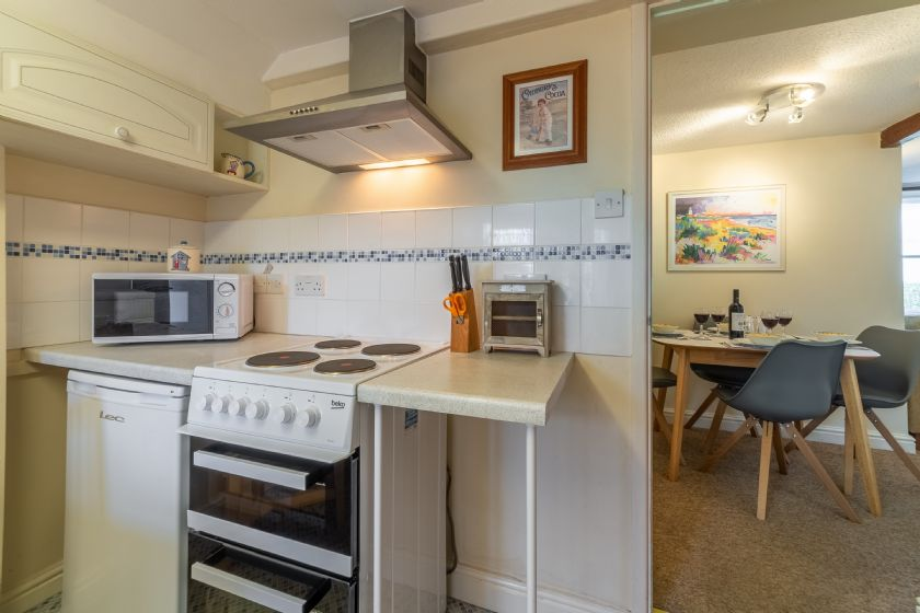 Ground floor: Kitchen with cooker and microwave