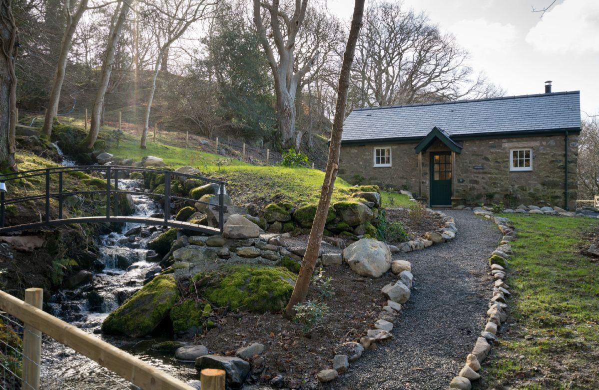 A delightful stream runs through the garden with a little bridge