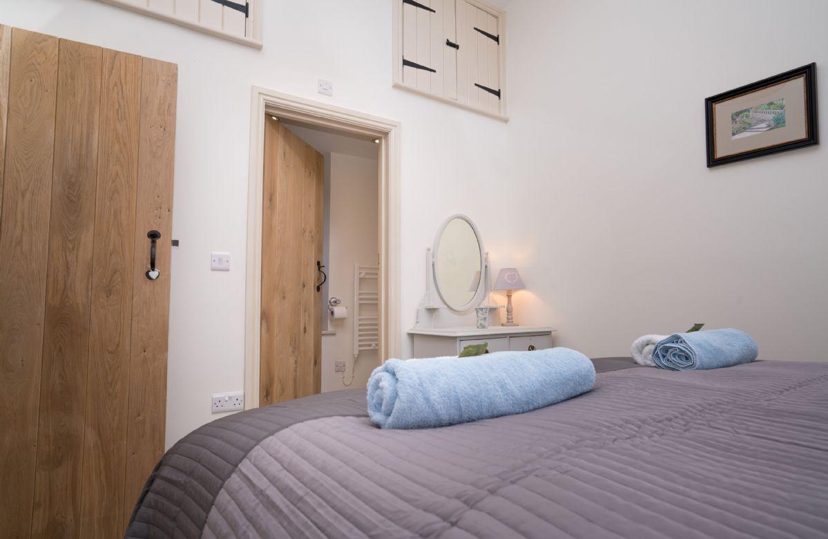 Ground floor: The bedroom benefits from an en-suite shower room