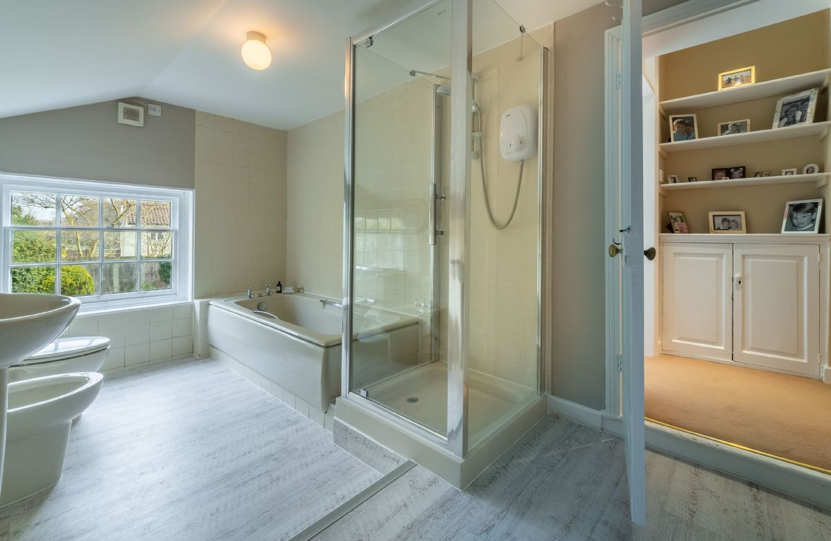 First floor: En-suite bathroom with bath and walk in shower