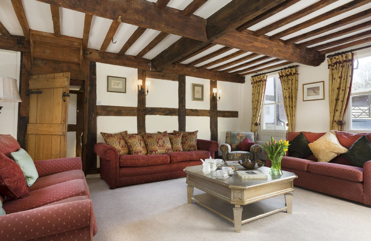 Ground floor: The spacious drawing room with exposed beams and open fire