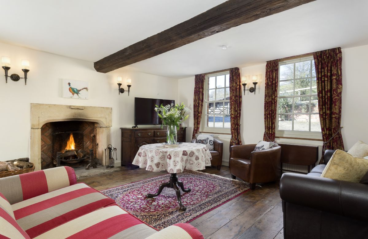 Ground floor: Sitting room with open fire and sash windows