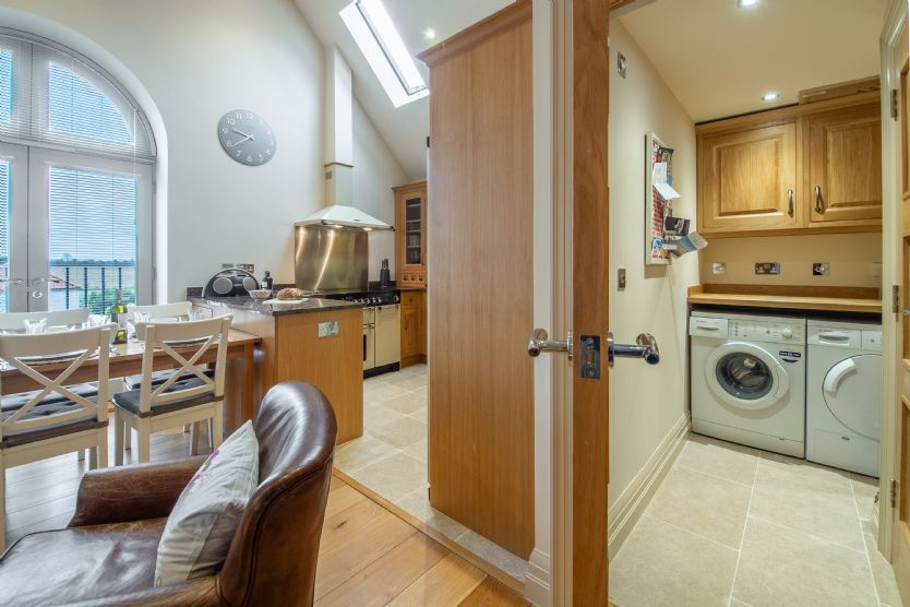 First floor: Utility adjoining the kitchen