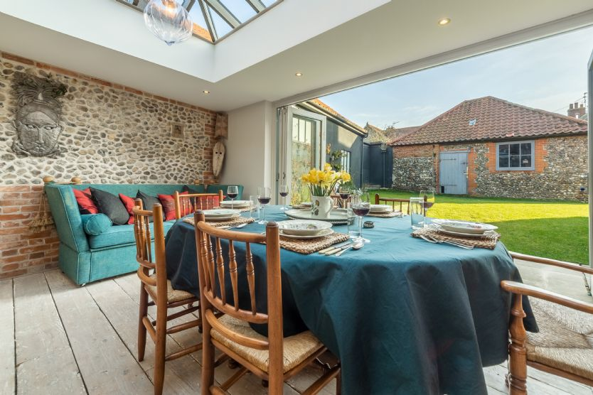 Ground floor: From the dining area, bi-fold doors lead to the garden