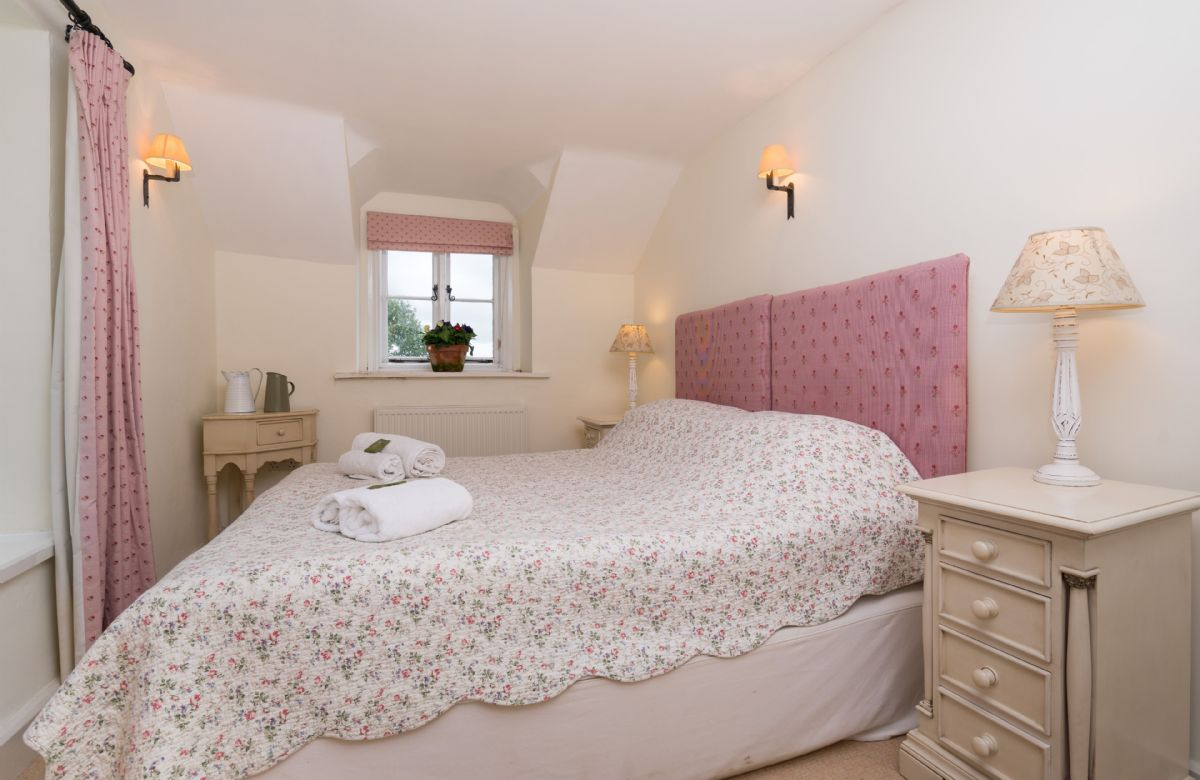 First floor:  Double bedroom with king size zip and link beds (can be converted into twin beds on request)