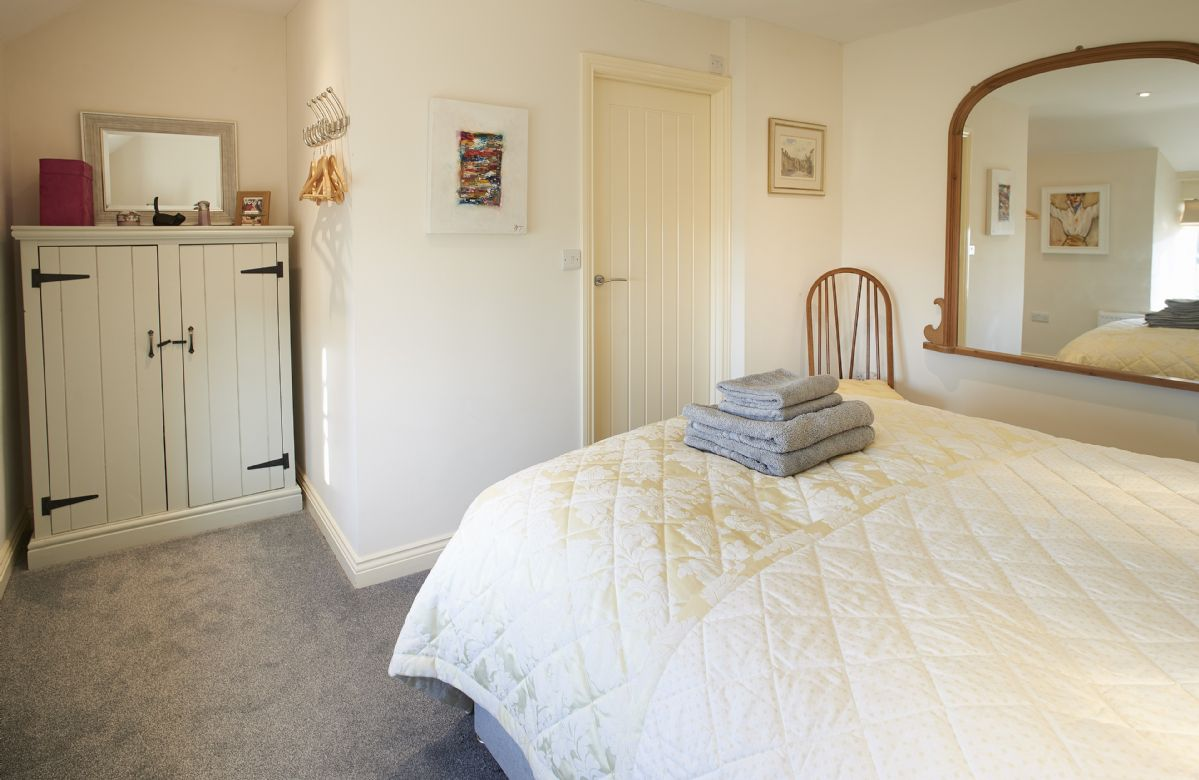First floor: Double bedroom with king size bed and en-suite