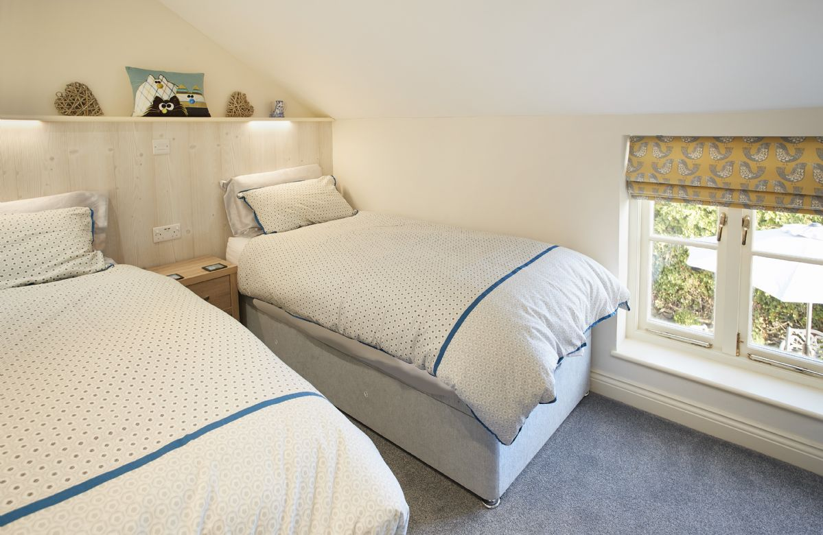 First floor: Delightful double bedroom with twin beds