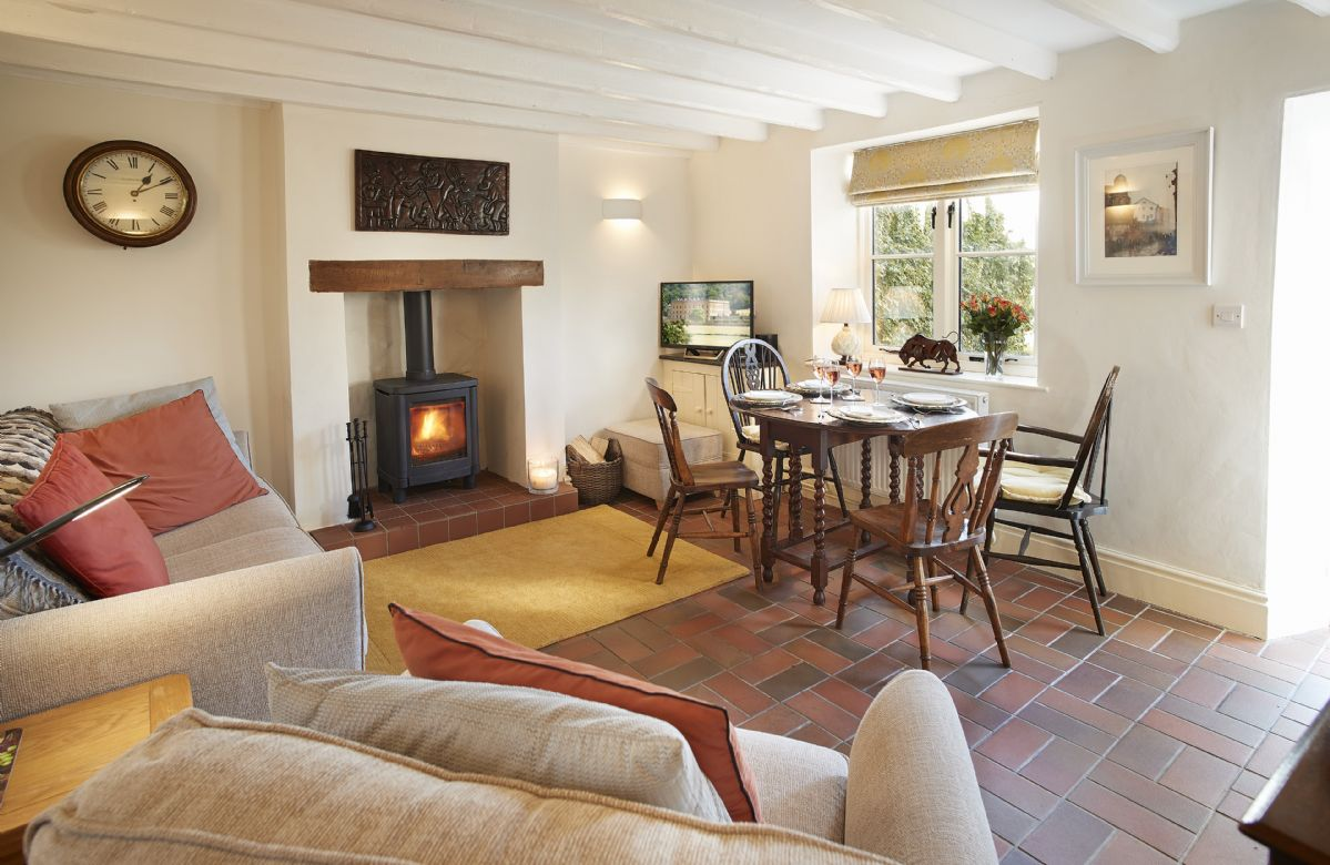 Ground floor: Sitting room with cosy wood burner and dining table