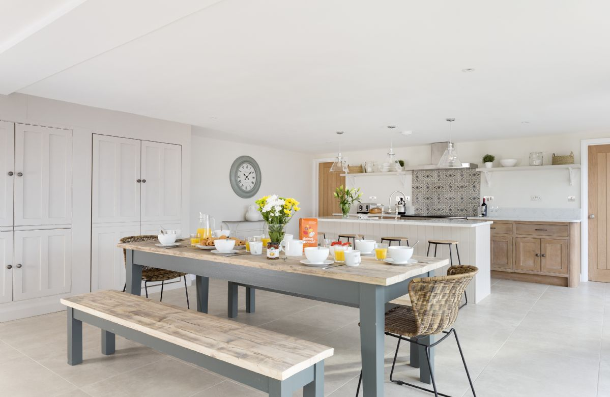 Ground floor: Open-plan kitchen with dining table and seating for ten guests