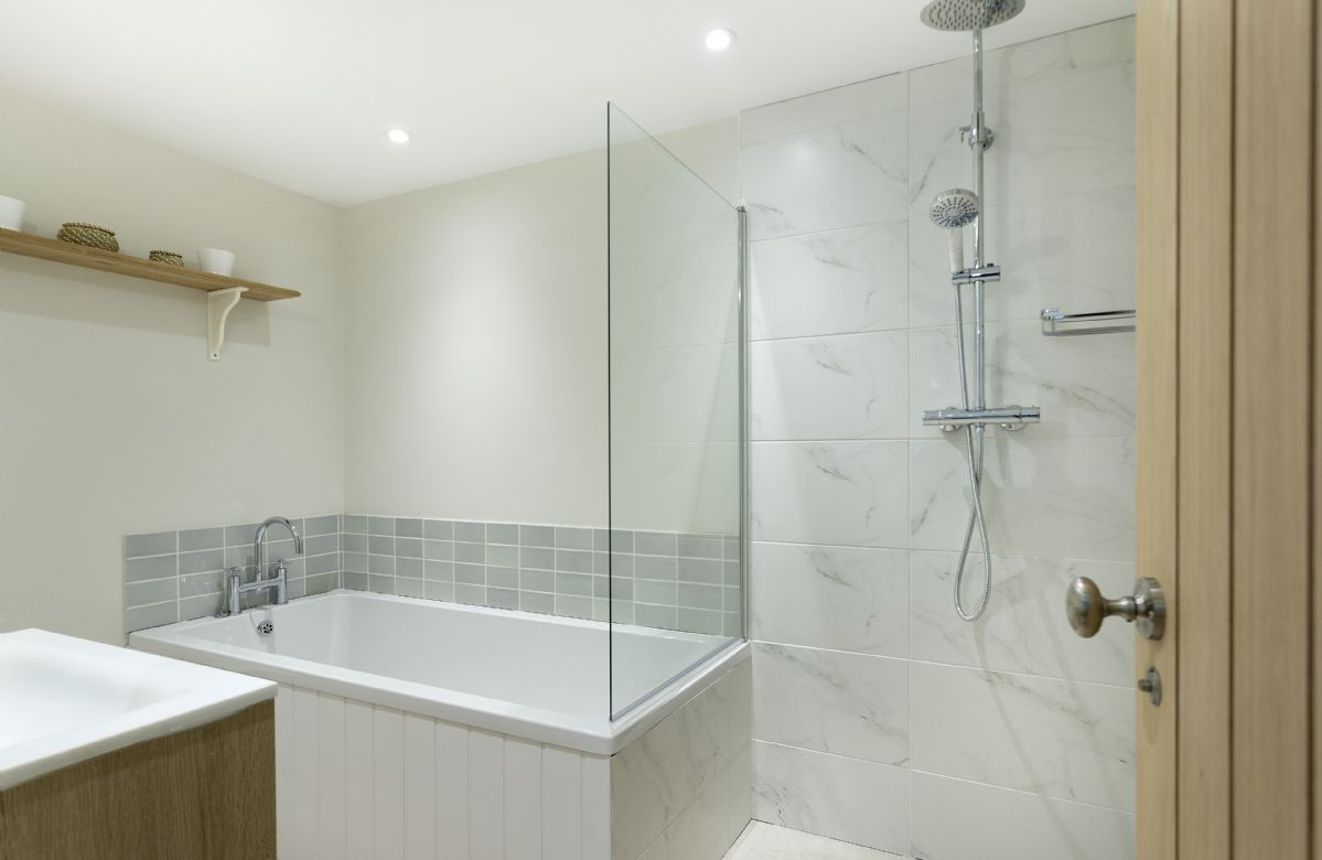 Ground floor:  A luxury en-suite with bath and walk-in shower