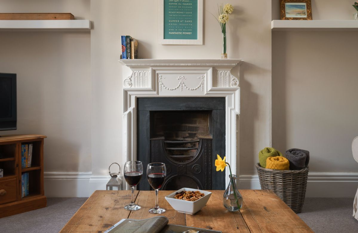 Ground floor: Decorative fireplace in the sitting room