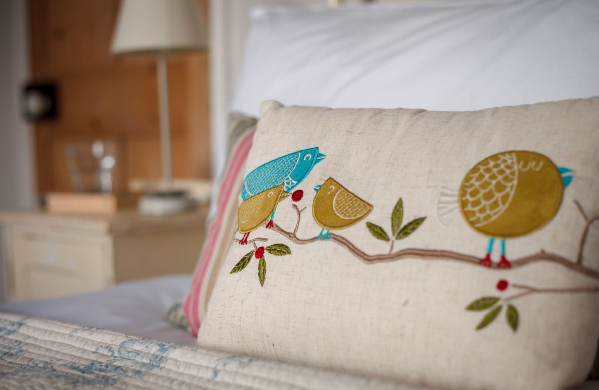 The double bedroom is decorated with charming touches