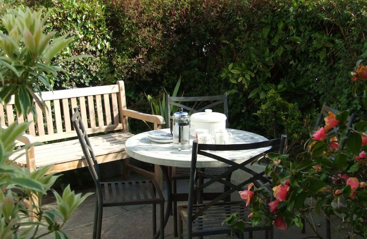 The patio is a real sun trap and an excellent spot for morning coffee