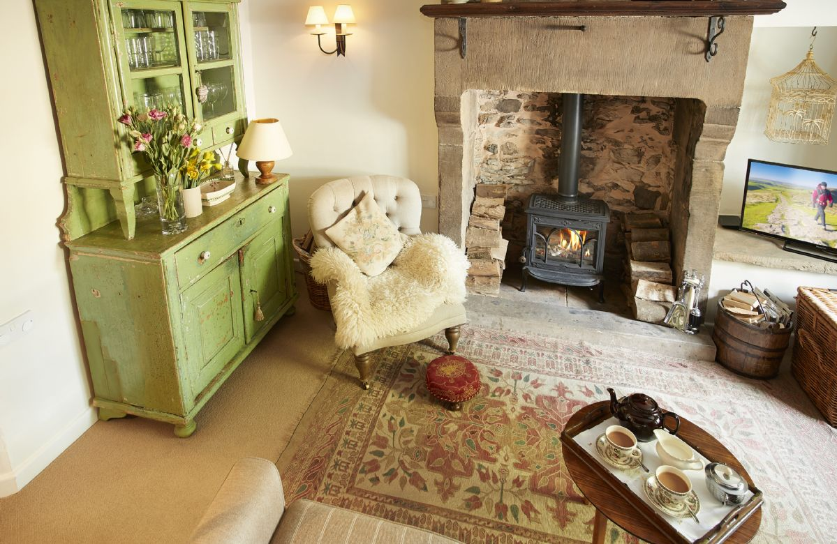 Ground floor: The comfortable sitting room with wood burning stove and traditional dresser