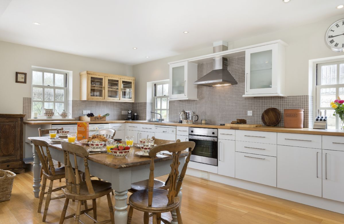 Ground floor: Well equipped kitchen with large farmhouse dining table