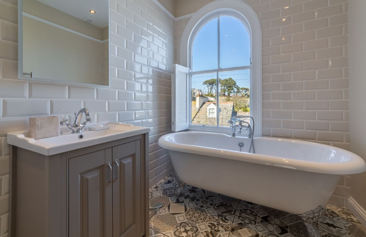 First floor: Stunning bathroom with roll top bath and views of the estuary