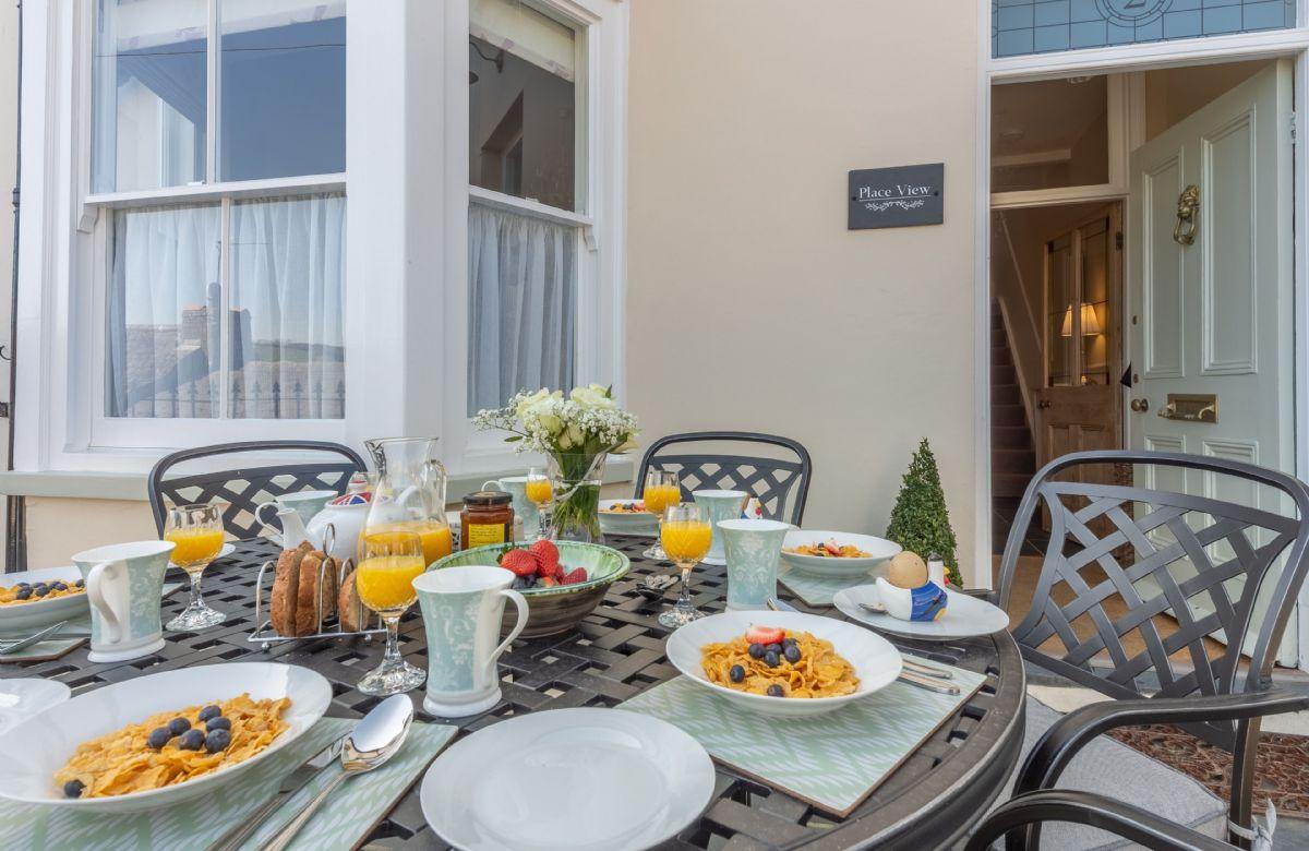 Enjoy breakfast al fresco on the sunny patio area