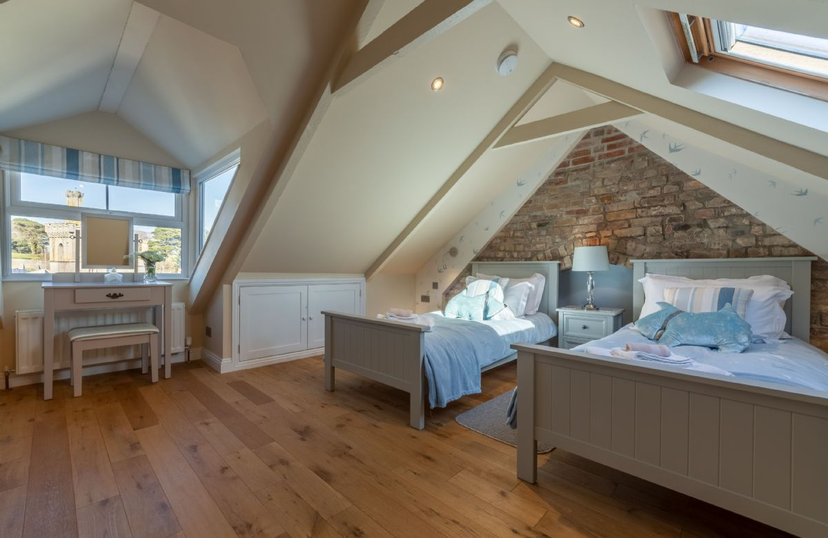 Second floor: Charming twin beds on the top floor with dressing table