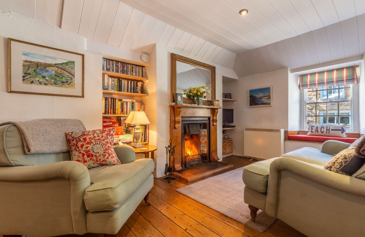 Open plan sitting room with wood burning stove