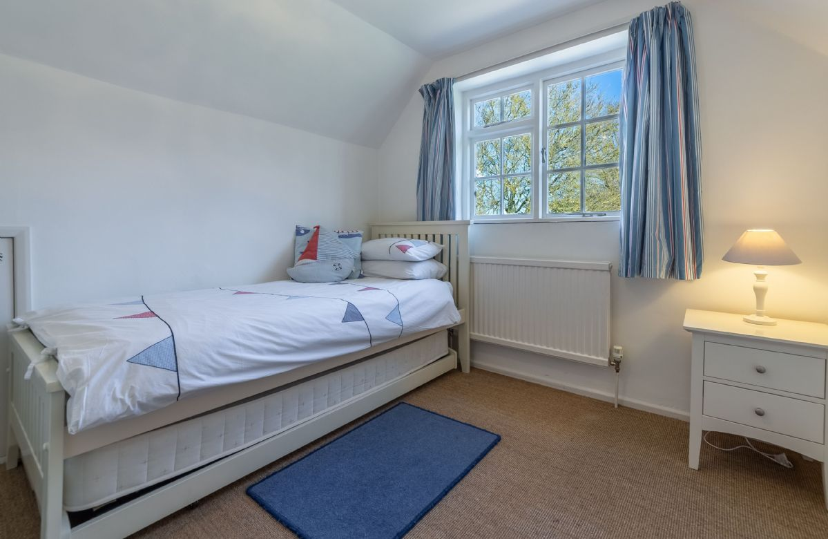 First floor:  Bedroom three with 3' single bed and truckle bed for an additional child
