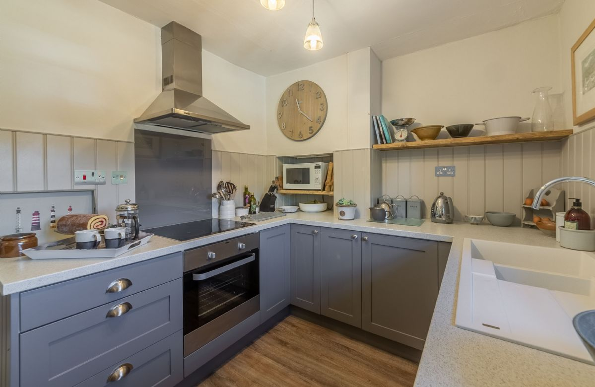 First floor: Kitchen with modern painted units, granite worktops and a Butlers sink