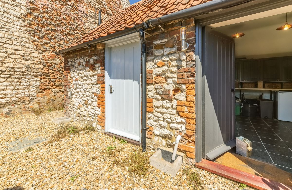 There is a handy outbuilding that is used as a utility room