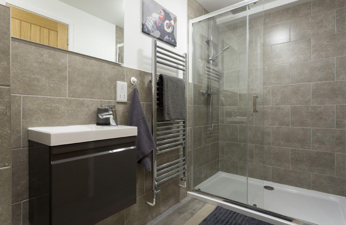 Ground floor: En-suite shower room adjacent to bedroom one