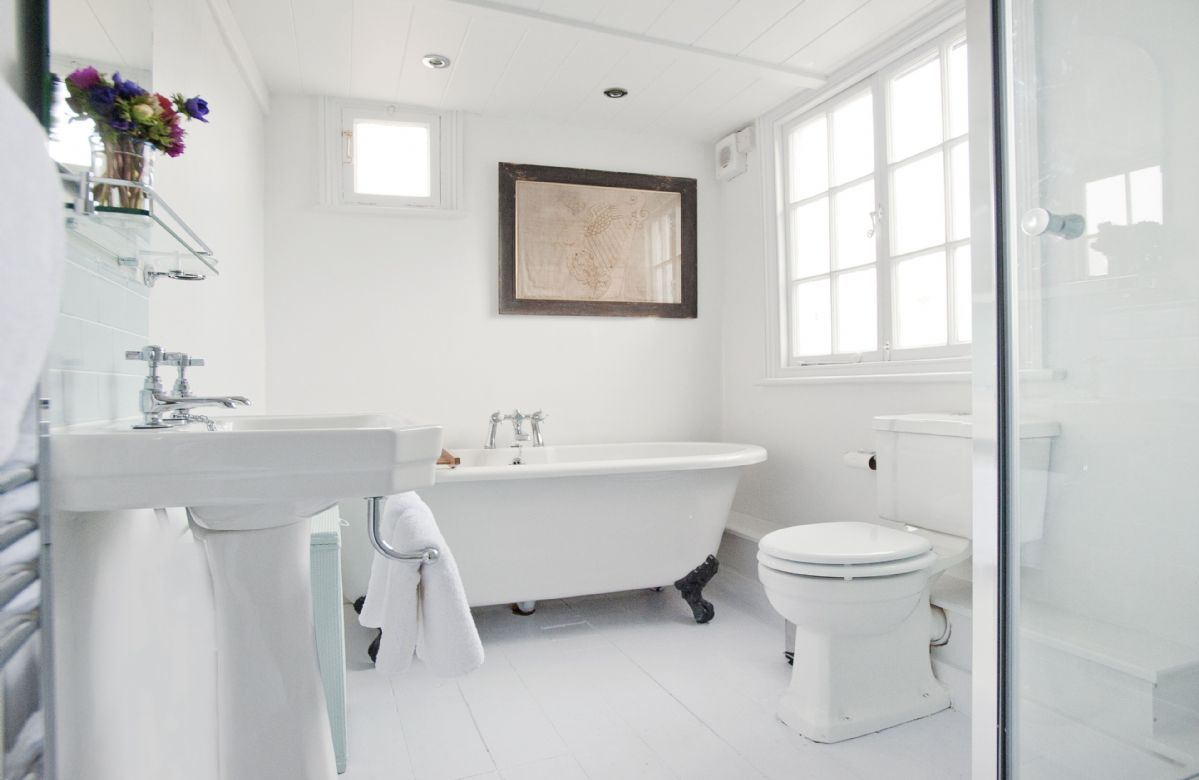 Bathroom with walk in high pressure shower and claw foot roll-top bath for two