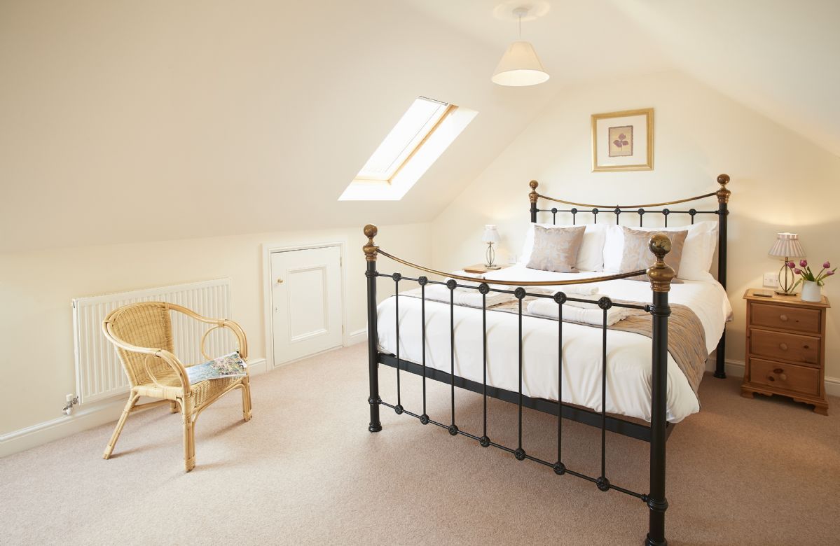 First floor: Double bedroom with king size bed in the eaves of the property