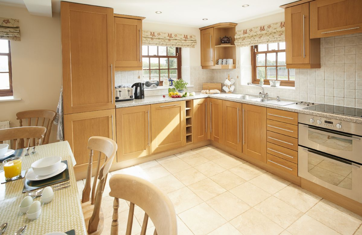 Ground floor: Luxury fully fitted kitchen with dining table seating seven guests