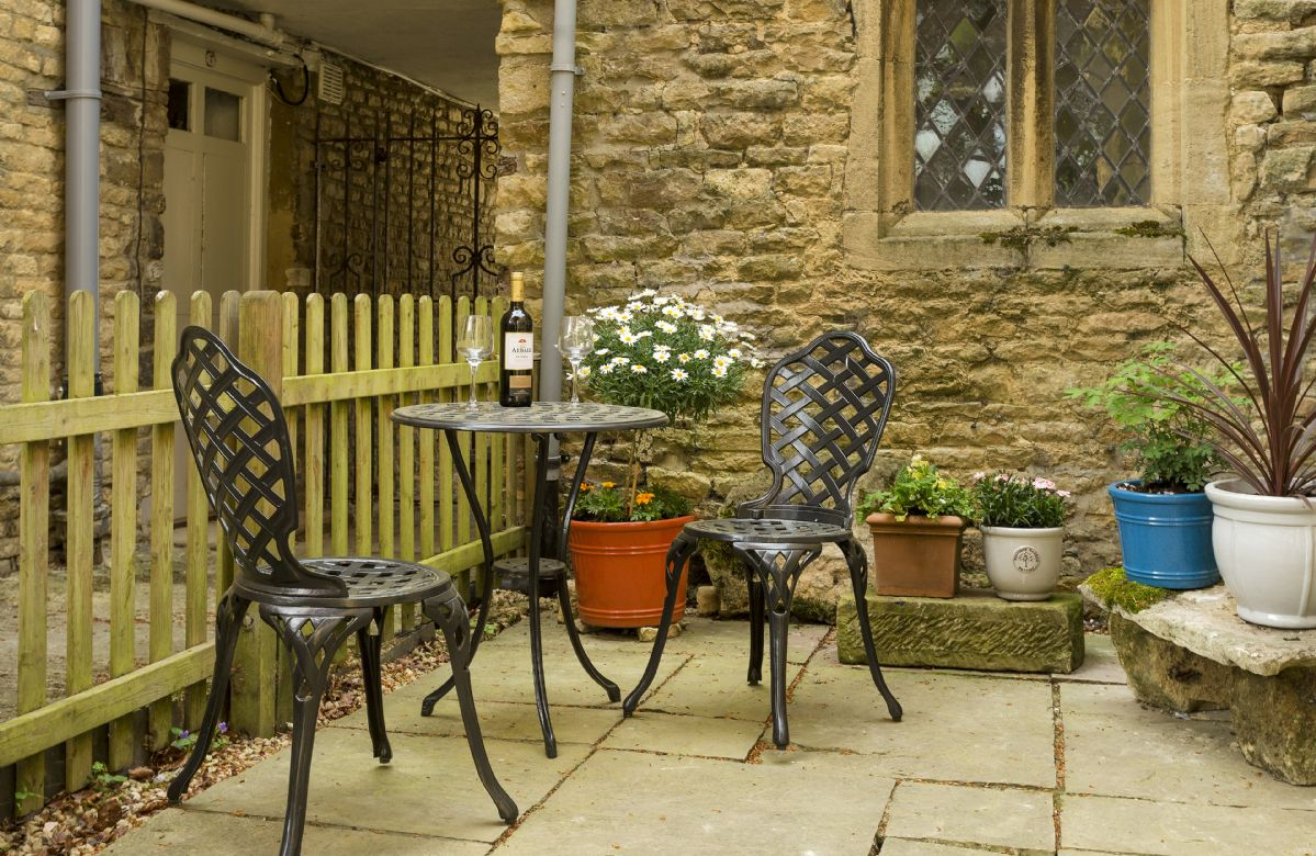 Courtyard garden with bistro dining set for two