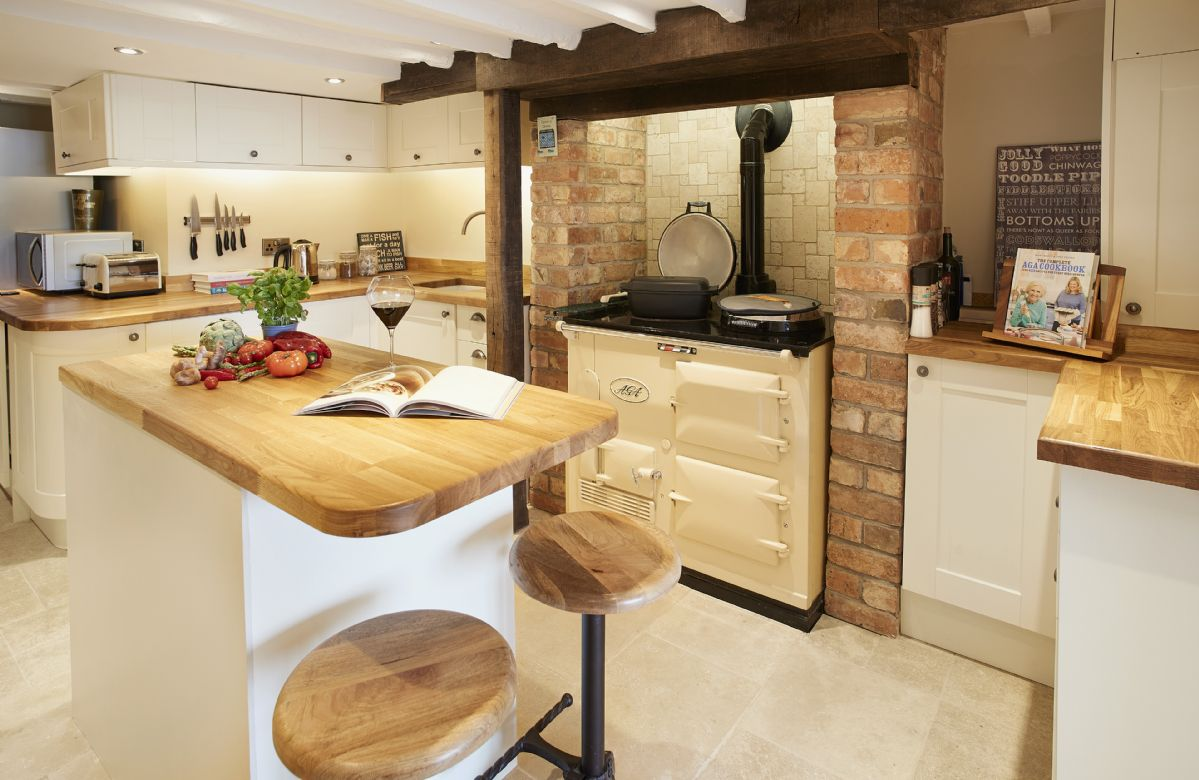 Lower ground floor:  Cosy kitchen with Aga and central island