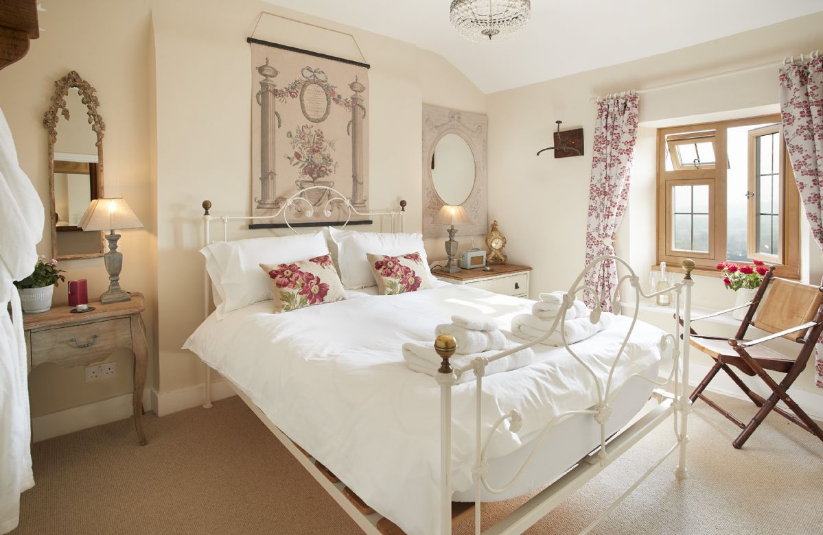 First floor:  The bedroom with a 5' king-size bed and rear views of the stunning countryside and deer park