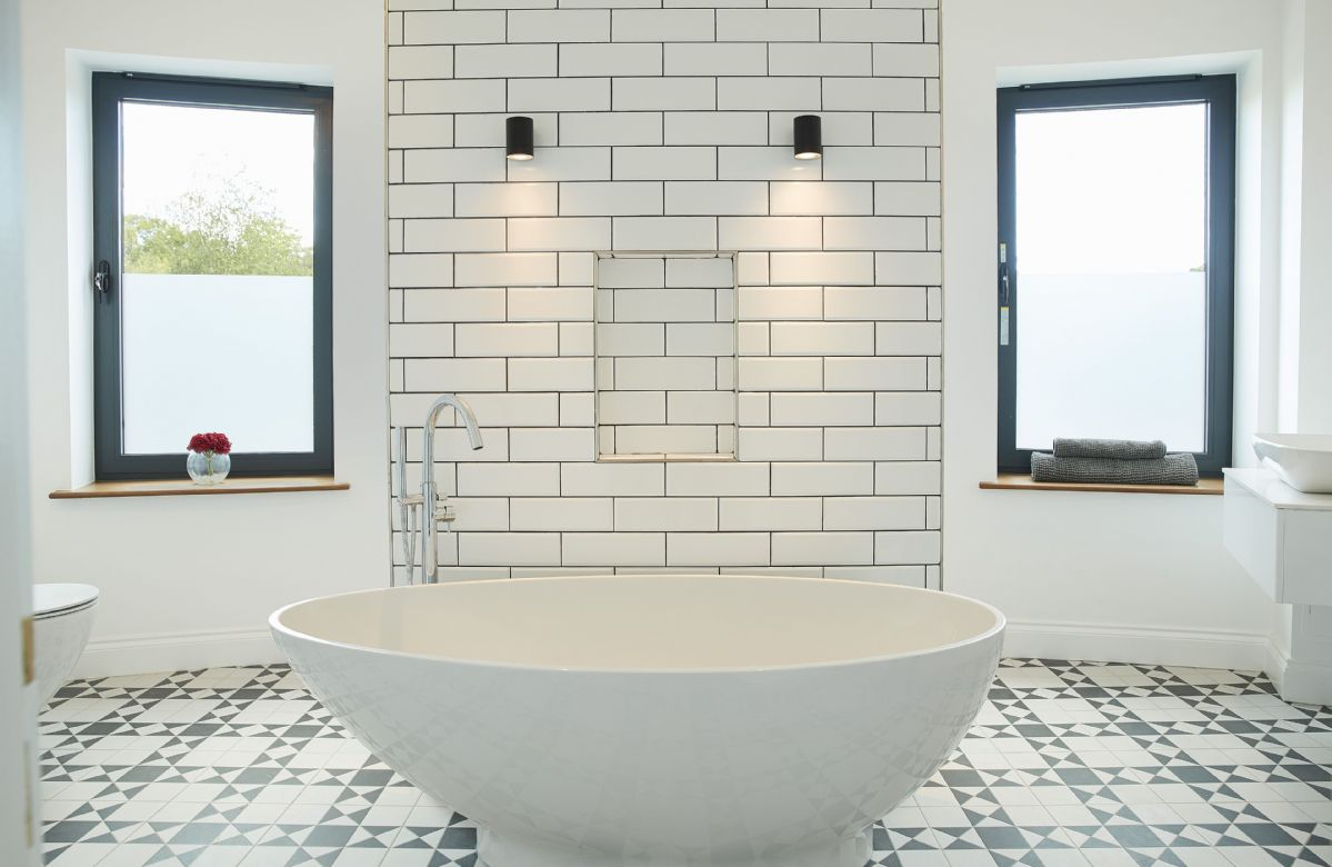 First floor: Master bathroom with circular shower room and luxurious bath