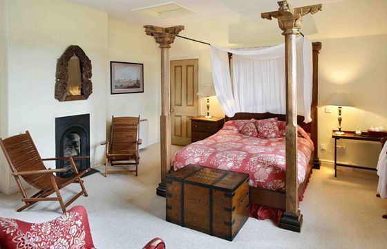 First floor: The double bedroom has its original fireplace, a splendid four poster bed and custom made furniture