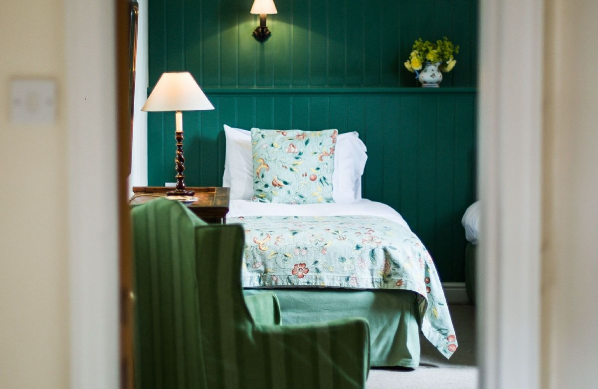 First floor: Calming colours of green and cream in the twin bedroom