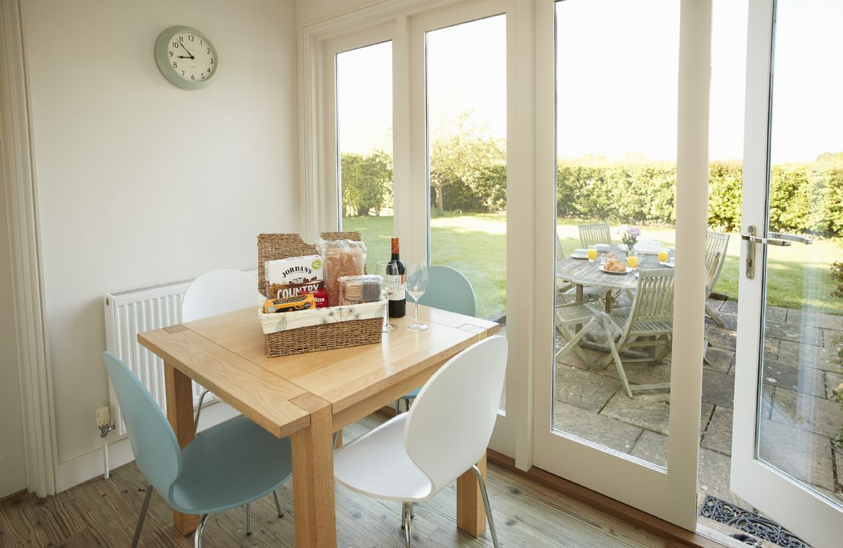 Ground floor: Breakfast room with seating fro four guests and views of the garden