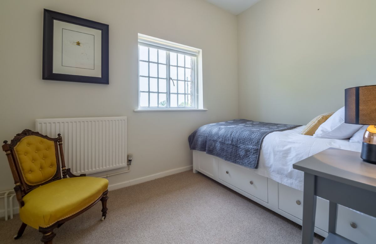 First floor: Single room with 3' single bed and views of the parkland