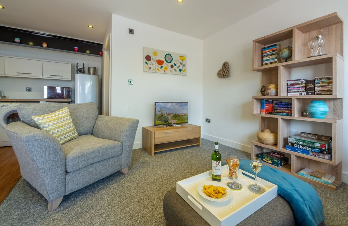 Ground floor: The spacious sitting room with comfortable sofas