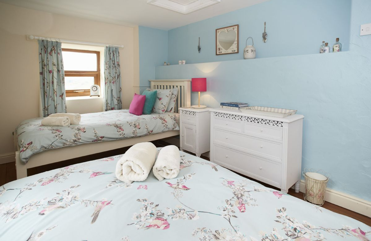 First floor: Double bedroom with twin beds