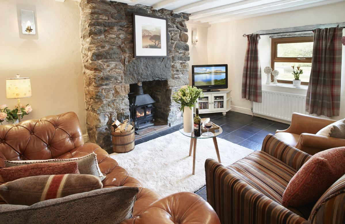 Ground floor: The comfortable sitting room with wood burning stove