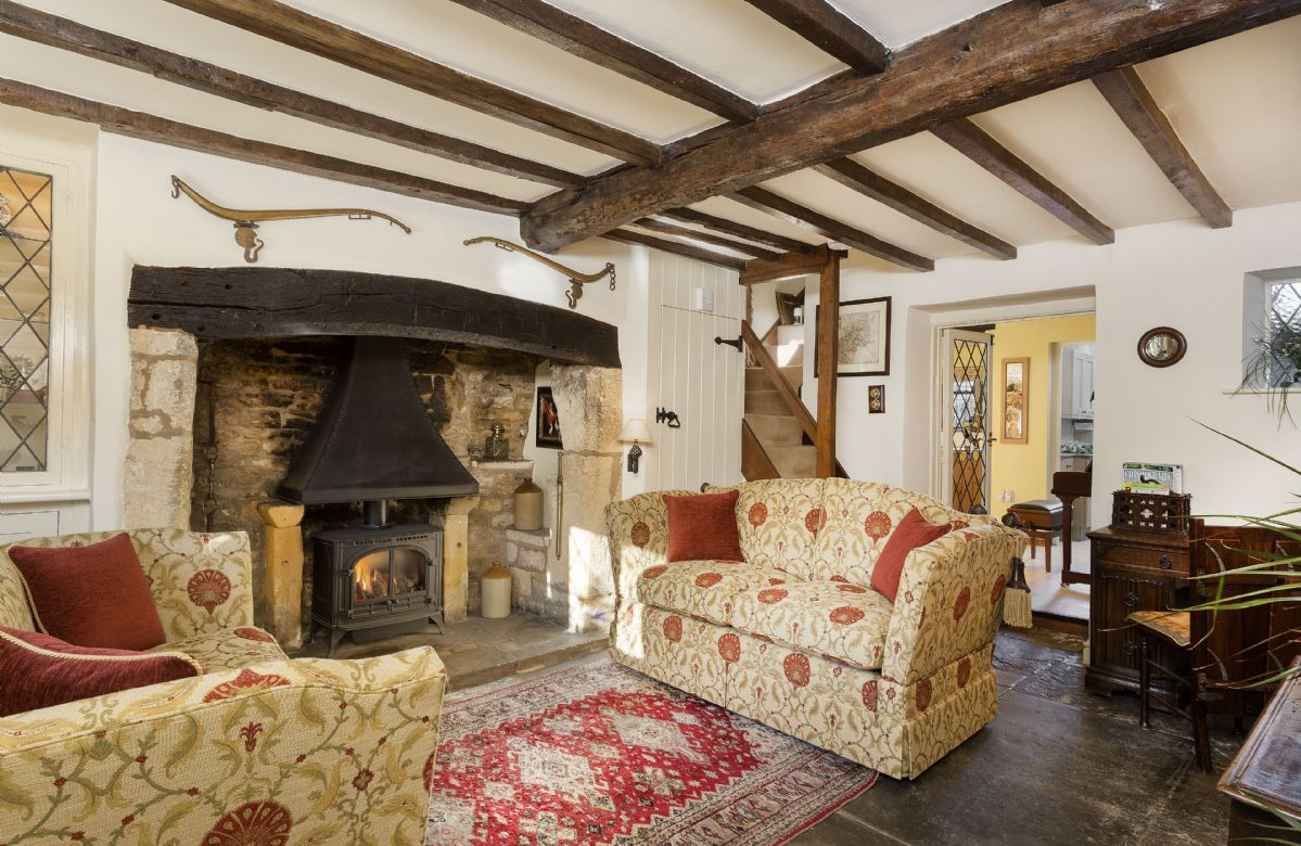 Ground Floor: Sitting room with gas effect wood burning stove.